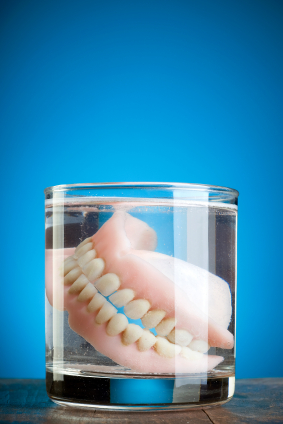 Can You Brush Your Dentures While They Are in Your Mouth?